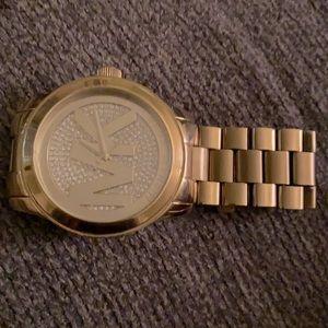 MK diamond flooded gold watch